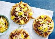 """<p>You'll want to use the pineapple slaw on everything.</p><p>Get the <a href=""""https://www.delish.com/uk/cooking/recipes/a29186647/pulled-pork-tacos-with-pineapple-slaw-recipe/"""" rel=""""nofollow noopener"""" target=""""_blank"""" data-ylk=""""slk:Pulled Pork Tacos with Pineapple Slaw"""" class=""""link rapid-noclick-resp"""">Pulled Pork Tacos with Pineapple Slaw</a> recipe. </p>"""