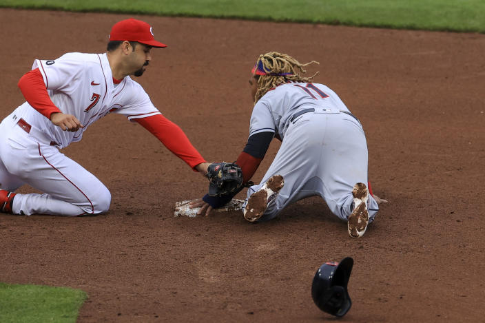 Cleveland Indians' Jose Ramirez, right, steals second base ahead of a tag by Cincinnati Reds' Eugenio Suarez, left, during the fifth inning of a baseball game in Cincinnati, Saturday, April 17, 2021. (AP Photo/Aaron Doster)