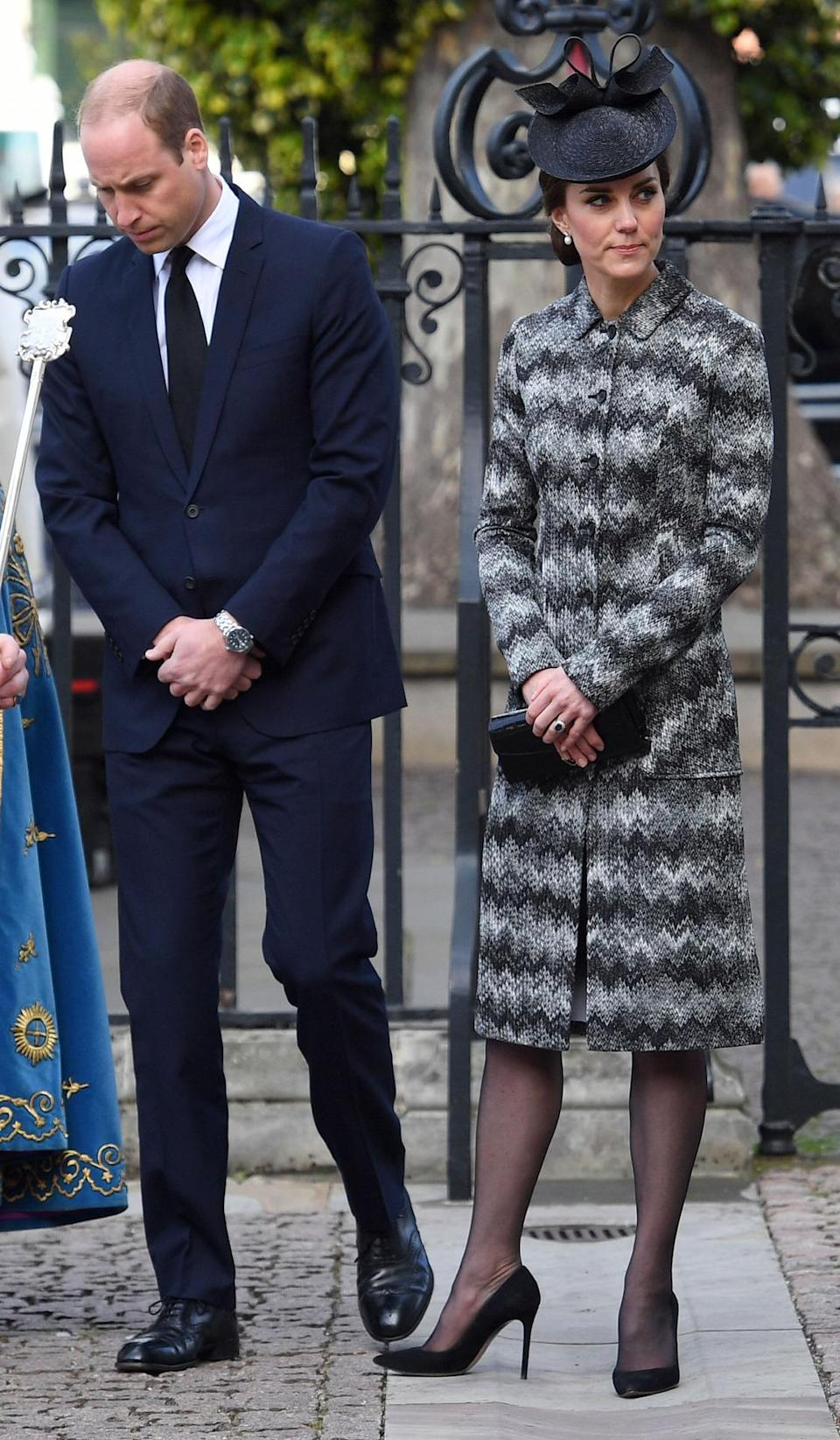 <p>The Duchess chose a suitably sombre look for a memorial service remembering the victims of the Westminster attack. She wore a zig-zag printed coat by Missoni (costing £2900) with a bow-topped black hat. A black clutch and heeled pumps added to the dark ensemble.</p><p><i>[Photo: PA]</i> </p>