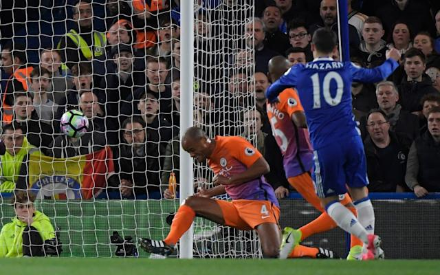 <span>Eden Hazard scores their first goal after a deflection by Manchester City's Vincent Kompany</span> <span>Credit: REUTERS </span>