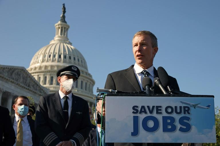 United Airlines CEO Scott Kirby is seen at a rally in Washington pressing for congressional support for the pandemic-hit economy. While Kirby has given back part of his salary, other CEOs have seen their compensation largely intact in the crisis