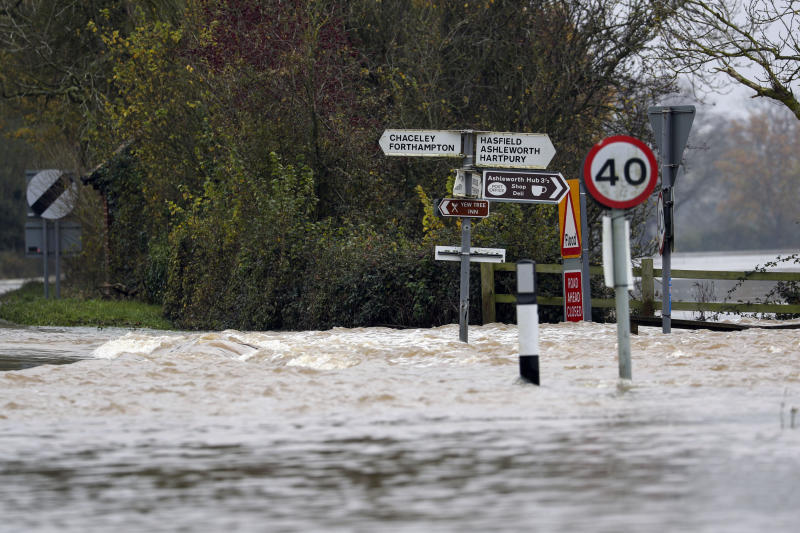 Floodwaters swamp a road in Tirley, near Tewkesbury, England, Sunday Nov. 17, 2019. Severe flooding has inflicted many parts of the country and a cold front is expected. (Steve Parsons/PA via AP)