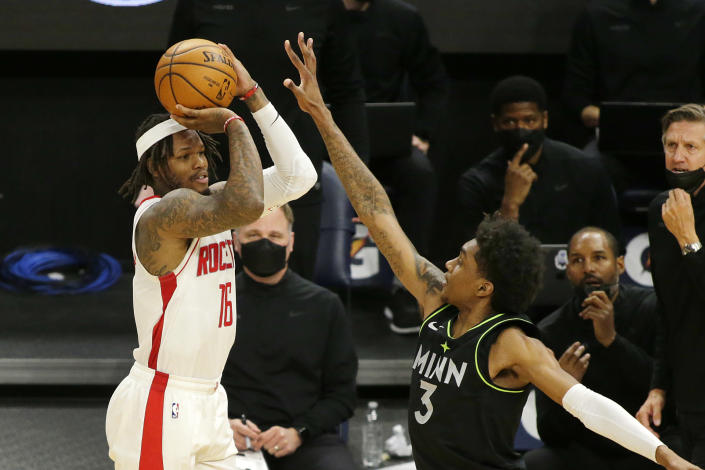 Houston Rockets guard Ben McLemore (16) shoots against Minnesota Timberwolves forward Jaden McDaniels (3) in the fourth quarter during an NBA basketball game, Friday, March 26, 2021, in Minneapolis. (AP Photo/Andy Clayton-King)