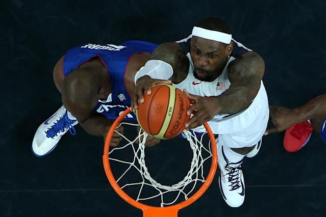 LONDON, ENGLAND - JULY 29: Lebron James #6 of United States dunks the ball over Ali Traore #8 of France during their Men's Basketball Game on Day 2 of the London 2012 Olympic Games at the Basketball Arena on July 29, 2012 in London, England. (Photo by Rob Carr/Getty Images)