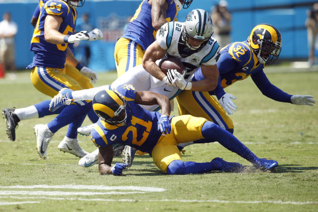 Carolina Panthers running back Christian McCaffrey (22) is tacklesd by Los Angeles Rams cornerback Aqib Talib (21) and free safety Eric Weddle (32) during the first half of an NFL football game in Charlotte, N.C., Sunday, Sept. 8, 2019. (AP Photo/Brian Blanco)