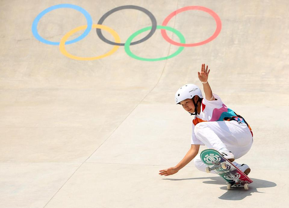 """<p>No skating by here! 13-year-old Momiji Nishiya of Team Japan became the first gold medalist in women's street skateboarding during the sport's Olympic debut July 26.</p> <p>In getting the gold, the teen also became Japan's youngest-ever Olympic medalist, per the <a href=""""https://apnews.com/article/sports-japan-skateboarding-8263196a3a074dc3ff83f6306213818a"""" rel=""""nofollow noopener"""" target=""""_blank"""" data-ylk=""""slk:AP."""" class=""""link rapid-noclick-resp"""">AP.</a> Rayssa Leal, 13, of Brazil, took silver, while Funa Nakayama, 16, also of Japan, won bronze.</p> <p>In scoring silver, Leal also become her country's youngest-ever medalist, on what the <a href=""""https://olympics.com/tokyo-2020/en/news/13-year-old-nishiya-momiji-wins-first-ever-women-s-street-skateboarding-gold"""" rel=""""nofollow noopener"""" target=""""_blank"""" data-ylk=""""slk:Olympic organization"""" class=""""link rapid-noclick-resp"""">Olympic organization</a> cited as """"what is believed to be the youngest Olympic podium ever.""""</p>"""