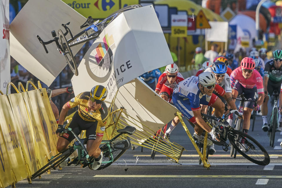 In this image released by World Press Photo, Thursday April 15, 2021, by Tomasz Markowski, titled Tour of Poland Cycling Crash, which won third prize in the Sports Singles category, shows Dutch cyclist, Dylan Groenewegen (left), crashes meters before the finish line, after colliding with fellow countryman Fabio Jakobsen during the first stage of the Tour of Poland, in Katowice, Poland, on August 5, 2020. (Tomasz Markowski, World Press Photo via AP)