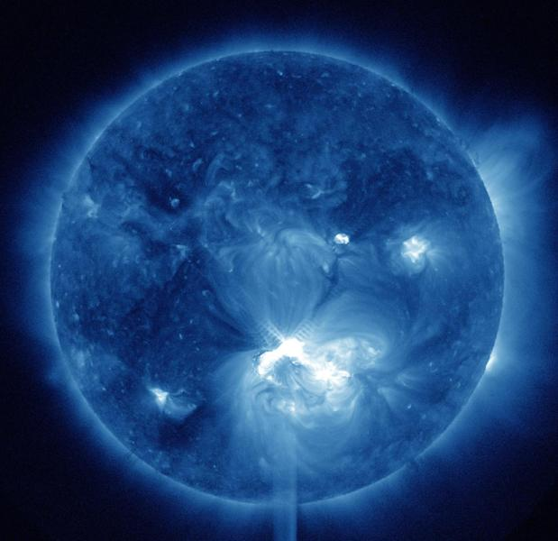 This false-color image provided by NASA shows a solar flare, lower center, erupting from the sun on Thursday, July 12, 2012. Space weather scientists said there should be little impact to Earth. The flare erupted from a region which rotated into view on July 6, 2012. (AP Photo/NASA)