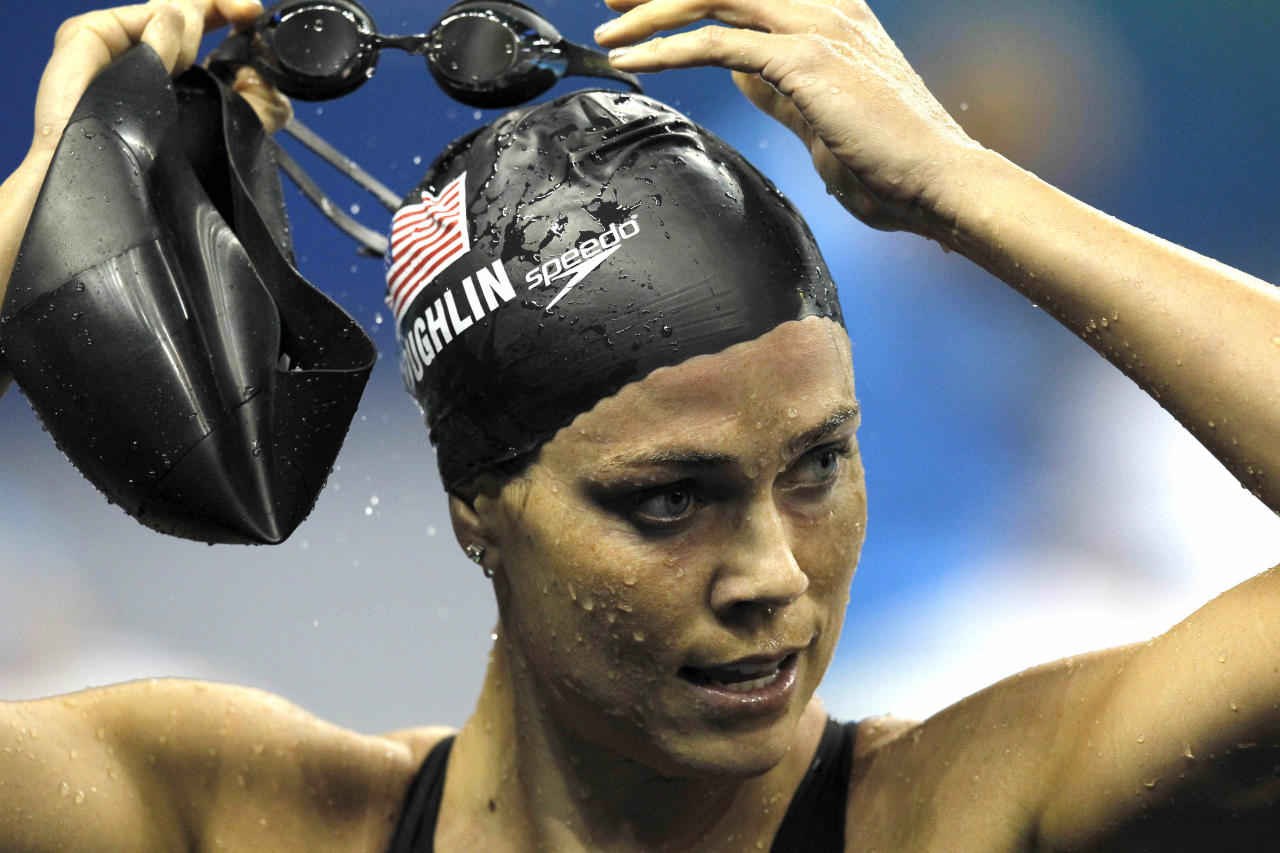 U.S. Natalie Coughlin takes off her goggles after completing a women's 100m Backstroke semifinal, at the FINA Swimming World Championships in Shanghai, China, Monday, July 25, 2011. (AP Photo/Wong Maye-E)