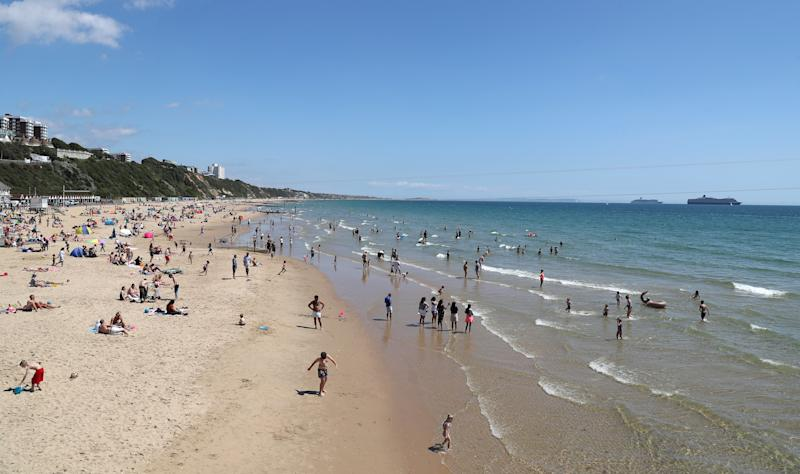 People visit the beach in Bournemouth as parts of the UK enjoy warm weather.