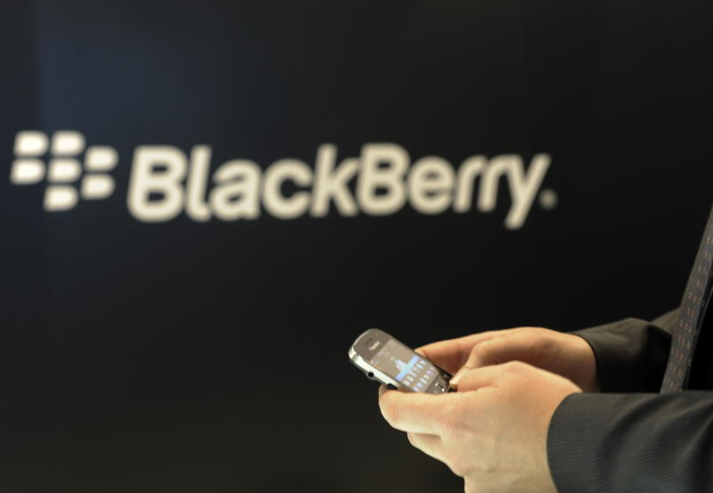 FILE - In this Nov. 8, 2011, file photo,  a Blackberry employee  holds a mobile phone of Blackberry in Berlin. Research In Motion (RIM) made another step towards the release of its new BlackBerry smartphones on Monday, Nov. 12, 2012, announcing that it plans to unveil the devices and its new operating system on Jan. 30. (AP Photo/dapd, Berthold Stadler)