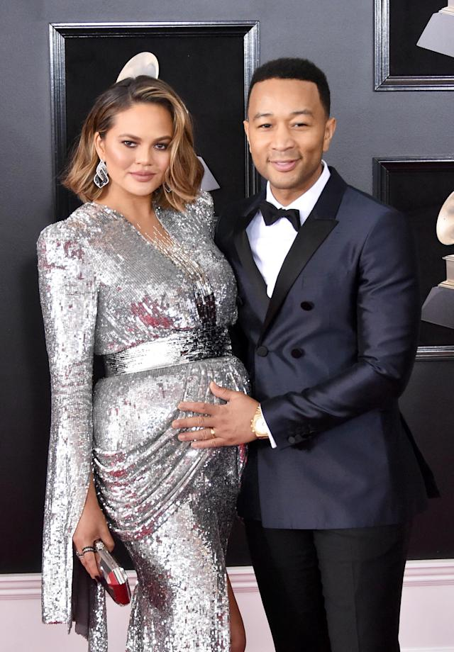 Chrissy Teigen and John Legend at the Grammy Awards Sunday night. (Photo: Getty Images)