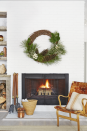 """<p>When it comes to holiday decorations, we say, the bigger the better. This supersize wreath—made with foraged materials—adds texture and interest to the simplistic fireplace found in <a href=""""https://www.countryliving.com/home-design/house-tours/g4930/lake-tahoe-winter-cabin-house-tour/?thumbnails="""" rel=""""nofollow noopener"""" target=""""_blank"""" data-ylk=""""slk:this California lakeside cabin"""" class=""""link rapid-noclick-resp"""">this California lakeside cabin</a>.</p><p><a class=""""link rapid-noclick-resp"""" href=""""https://www.amazon.com/s/ref=nb_sb_noss_1?url=search-alias%3Dgarden&field-keywords=grapevine+wreath&rh=n%3A1055398%2Ck%3Agrapevine+wreath&tag=syn-yahoo-20&ascsubtag=%5Bartid%7C10050.g.1247%5Bsrc%7Cyahoo-us"""" rel=""""nofollow noopener"""" target=""""_blank"""" data-ylk=""""slk:SHOP GRAPEVINE WREATHS"""">SHOP GRAPEVINE WREATHS</a></p>"""