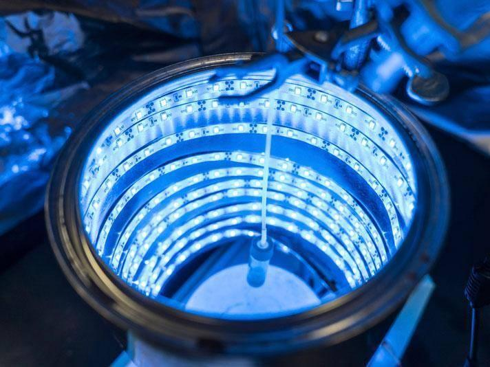 An artificial photosynthesis device glows blue like a tanning bed (UCF: Bernard Wilchusky)