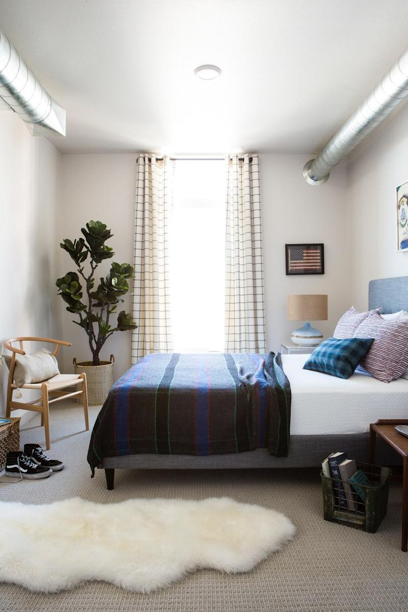 Max added height with gingham curtains in this master bedroom.