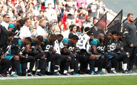 NFL Football - Jacksonville Jaguars vs Baltimore Ravens - NFL International Series - Wembley Stadium, London, Britain - September 24, 2017   Jacksonville Jaguars players kneel during the U.S. national anthem before the match   Action Images via Reuters/Andrew Boyers