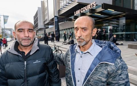 Brothers Yama Nabi and Omar Nabi (L-R) speak to the media about their father Daoud Nabi  - Credit: Getty