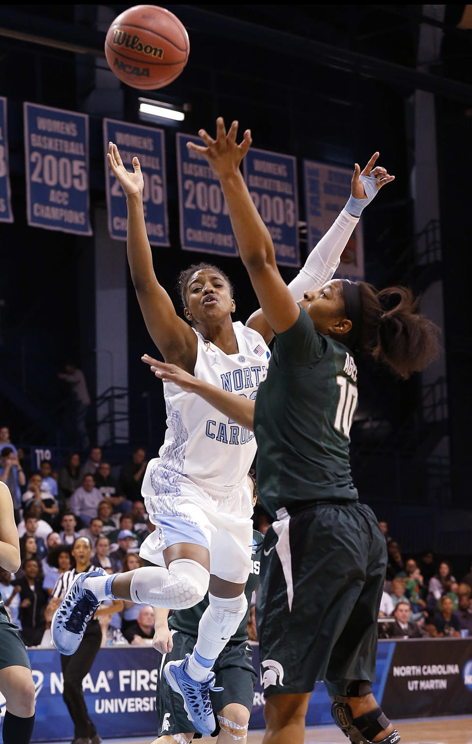 North Carolina's Diamond DeShields, left, battles Michigan State's Branndais Agee for the ball during the second half of a second-round game of the NCAA college basketball tournament in Chapel Hill, N.C. Tuesday, March 25, 2014. North Carolina beat Michigan State 62-53. (AP Photo/Ellen Ozier)