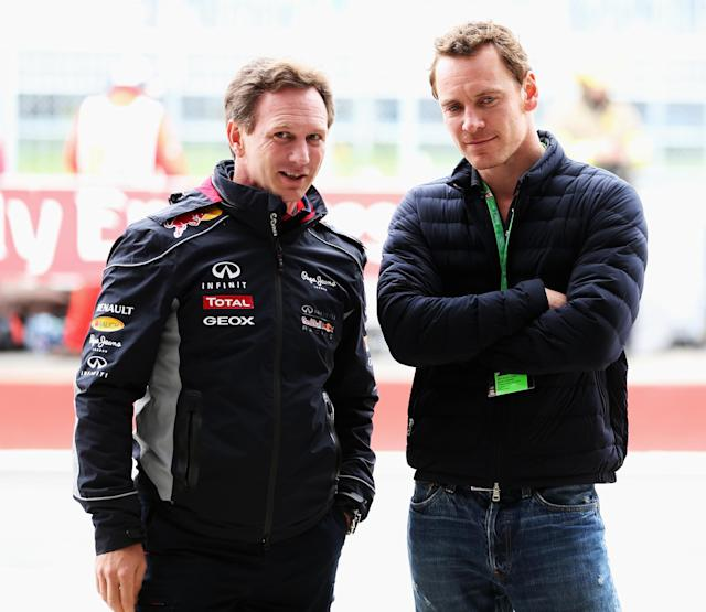 MONTREAL, QC - JUNE 08: Actor Michael Fassbender talks with Infinti Red Bull Racing Team Principal Christian Horner before the qualifying session for the Canadian Formula One Grand Prix at the Circuit Gilles Villeneuve on June 8, 2013 in Montreal, Canada. (Photo by Mark Thompson/Getty Images)