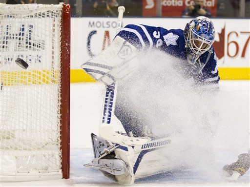 Toronto Maple Leafs goaltender Jonas Gustavsson makes a save against the Winnipeg Jets during the first period of an NHL hockey game, Thursday, Jan. 5, 2012, in Toronto. (AP Photo/The Canadian Press, Frank Gunn)