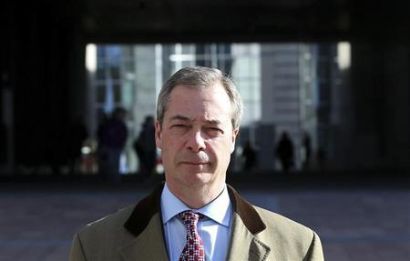 UKIP leader and MEP Farage walks outside the EU Parliament in Brussels