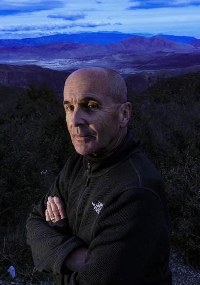 "JULIAN,CA., FEB 1, 2019: Thriller/crime novelist Don Winslow stands on a hilltop in San Diego County overlooking a portion of the Borrego Valley where people and drugs coming from Mexico intersect on the desert floor below him February 1, 2019. Winslow?s new book, ""The Border"" comes out in February. The novel is the third in a sweeping trilogy of America's drug wars (Mark Boster For the LA Times)."
