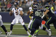 Denver Broncos quarterback Drew Lock (3) drops to pass against the Seattle Seahawks during the first half of an NFL preseason football game Saturday, Aug. 21, 2021, in Seattle. (AP Photo/Stephen Brashear)