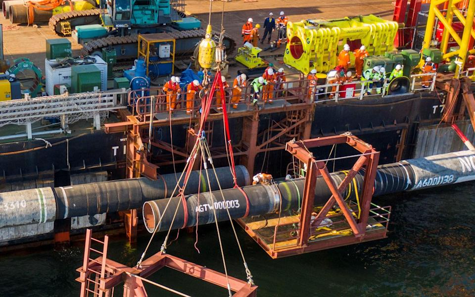 Specialists perform an above-water tie-in while finishing the construction of the Nord Stream 2 pipeline in the Baltic Sea - Reuters