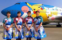 <p>Flight attendants from All Nippon Airways introduce the Pokemon Jet in June 1999 at Tokyo International Airport. The jet design was selected as the winner from the airline's Pokemon design contest.</p>