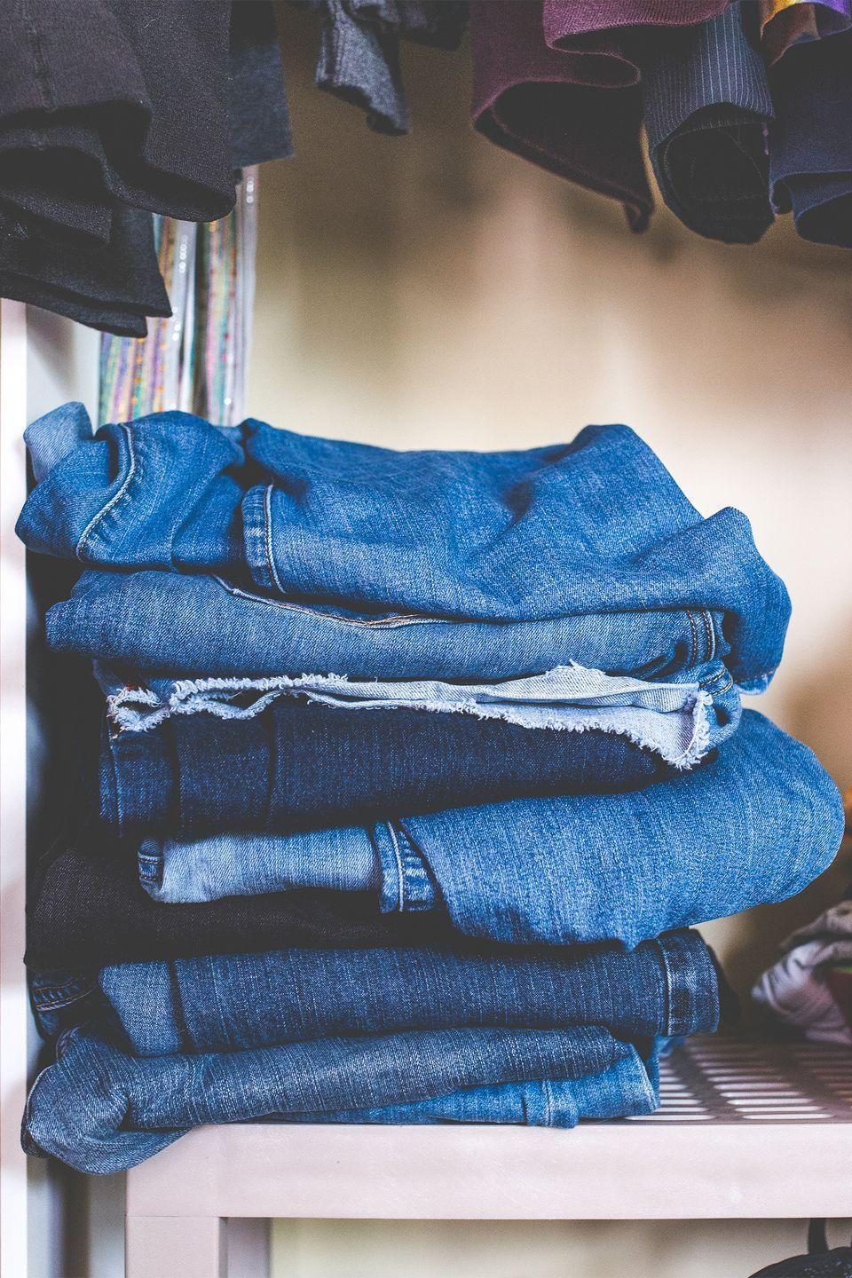"""<p>Free up drawer space by stacking jeans, sweaters, and gym clothes on closet shelves. Slip-on shelf dividers keep them from falling over.</p><p><strong><a class=""""link rapid-noclick-resp"""" href=""""https://www.amazon.com/mDesign-Divider-Organizer-Clothing-Storage/dp/B06WWGBBZZ?tag=syn-yahoo-20&ascsubtag=%5Bartid%7C10070.g.3310%5Bsrc%7Cyahoo-us"""" rel=""""nofollow noopener"""" target=""""_blank"""" data-ylk=""""slk:SHOP SHELF DIVIDERS"""">SHOP SHELF DIVIDERS</a></strong></p>"""