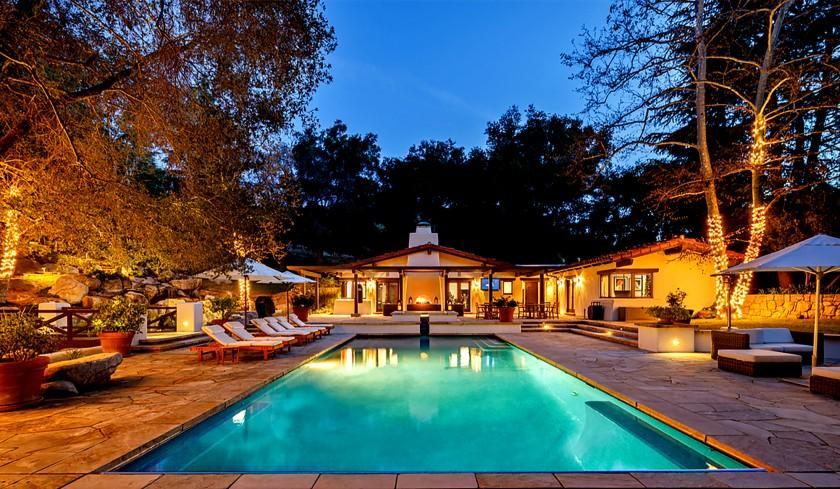 Spanish in style, the leafy compound sprawls across five acres in the Santa Monica Mountains above Malibu.
