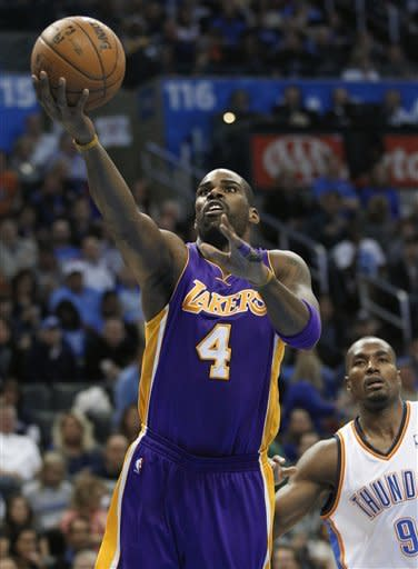 Los Angeles Lakers forward Antawn Jamison (4) shoots in front of Oklahoma City Thunder forward Serge Ibaka (9) in the first quarter of an NBA basketball game in Oklahoma City, Friday, Dec. 7, 2012. (AP Photo/Sue Ogrocki)