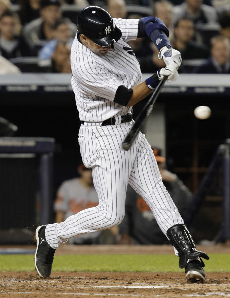 New York Yankees' Derek Jeter hits an RBI triple during the third inning of Game 3 of the Yankees' American League division baseball series against the Baltimore Orioles on Wednesday, Oct. 10, 2012, in New York. (AP Photo/Kathy Willens)
