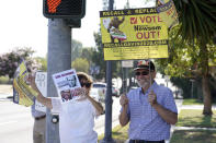 Supporters of the California recall of Gov. Gavin Newsom hold signs outside of a debate by Republican gubernatorial candidates at the Richard Nixon Presidential Library Wednesday, Aug. 4, 2021, in Yorba Linda, Calif. Newsom faces a Sept. 14 recall election that could remove him from office. (AP Photo/Marcio Jose Sanchez)