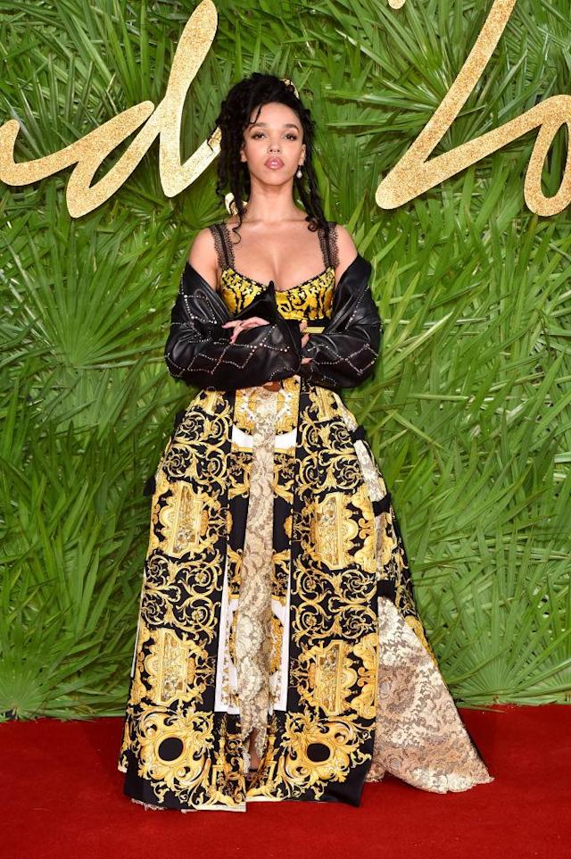 <p>FKA Twigs proved you can work denim on the red carpet as she draped a jacket over her printed gown. (Photo: Getty Images) </p>
