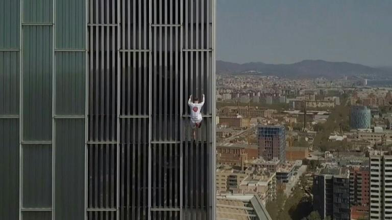 British free climber George King scales Barcelona building
