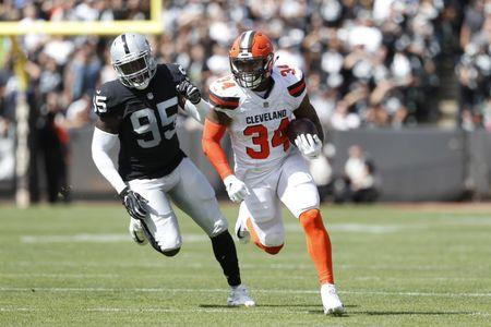 FILE PHOTO: Sep 30, 2018; Oakland, CA, USA; Cleveland Browns running back Carlos Hyde (34) runs the ball against the Oakland Raiders in the first quarter at Oakland Coliseum. Mandatory Credit: Cary Edmondson-USA TODAY Sports