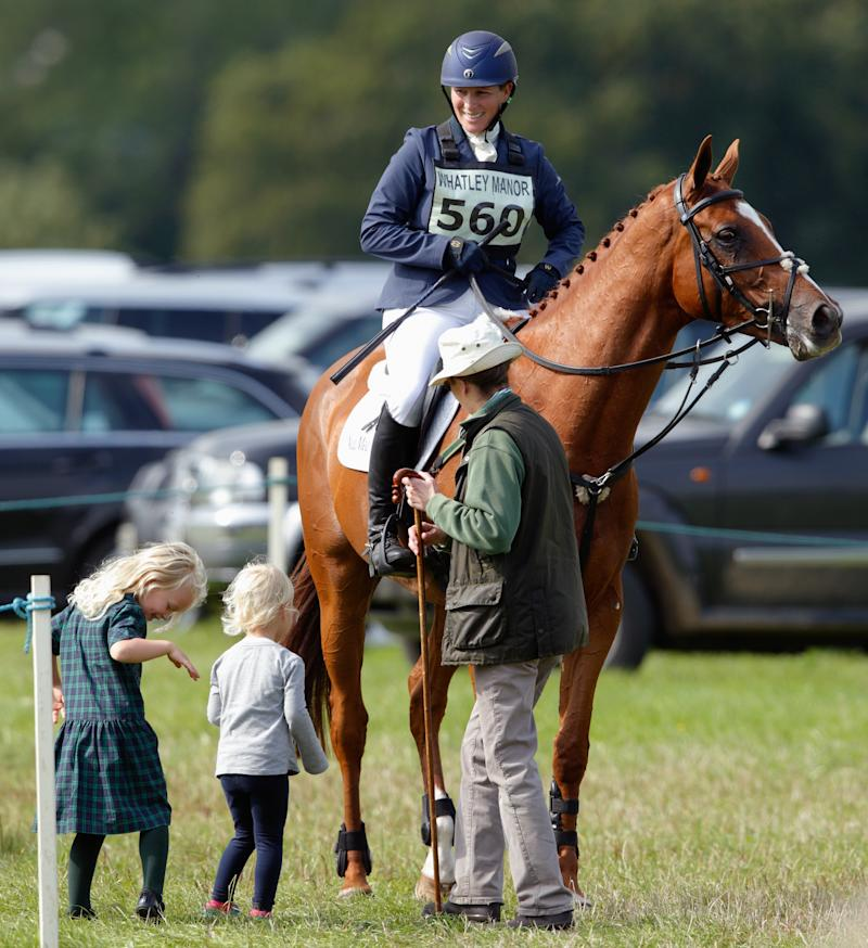 STROUD, UNITED KINGDOM - SEPTEMBER 11: (EMBARGOED FOR PUBLICATION IN UK NEWSPAPERS UNTIL 48 HOURS AFTER CREATE DATE AND TIME) Princess Anne, The Princess Royal and her grandchildren Isla Phillips and Savannah Phillips talk with Zara Phillips after she competed in the show jumping phase of the Whatley Manor International Horse Trials at Gatcombe Park on September 11, 2015 in Stroud, England. (Photo by Max Mumby/Indigo/Getty Images)