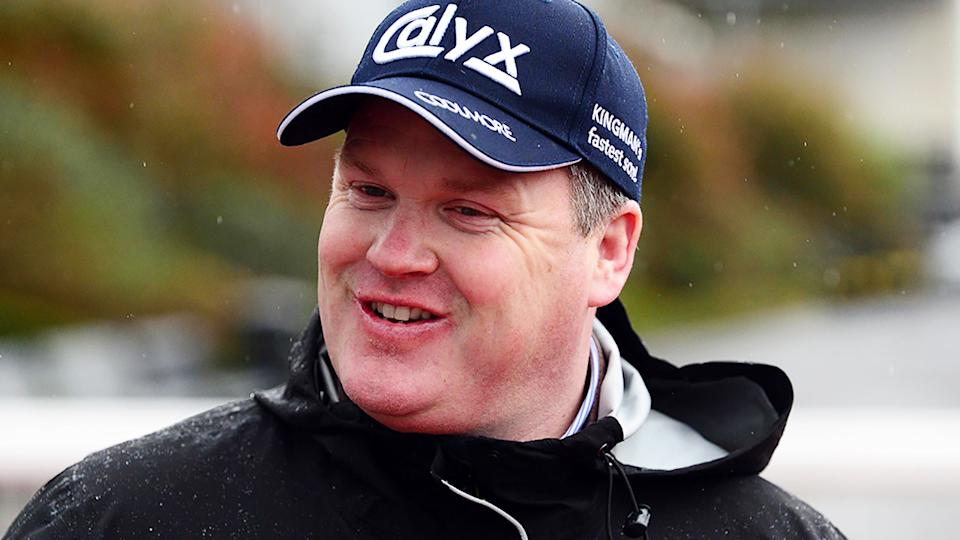 Trainer Gordon Elliott says he will cooperate fully with an investigation into a photo of him posing on top of a dead horse. (Photo by PA Wire/PA Images via Getty Images)