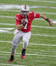 FILE - Ohio State quarterback Justin Fields runs with the ball during the first half of the Big Ten championship NCAA college football game against Northwestern in Indianapolis, in this Saturday, Dec. 19, 2020, file photo. Fields is a likely first round pick in the NFL Draft, April 29-May 1, 2021, in Cleveland.(AP Photo/Darron Cummings, File)