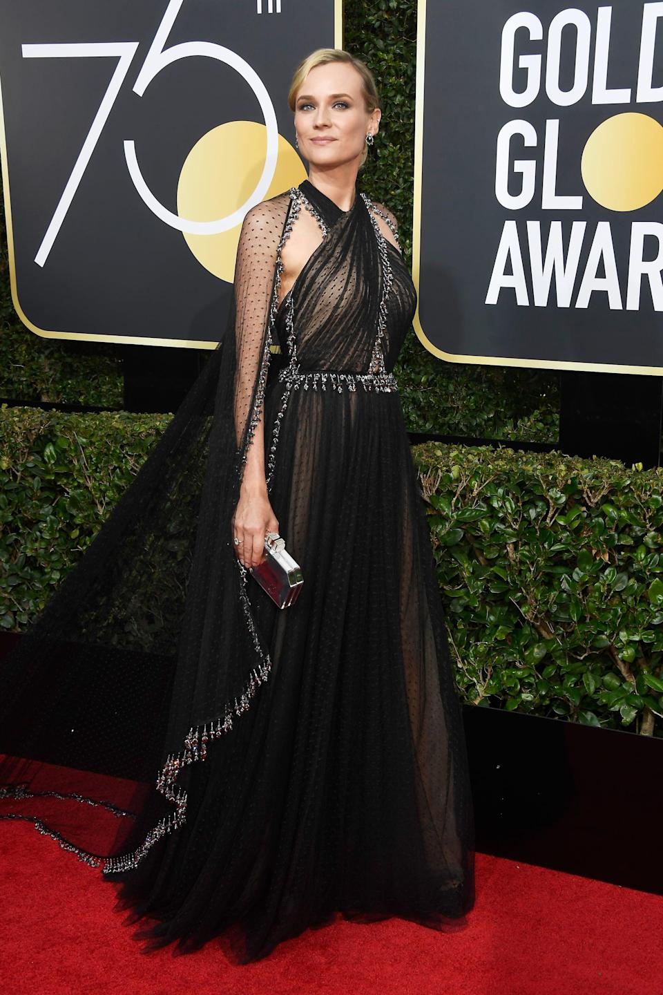 <p>Wearing a Prada dress with Fred Leighton jewels and a Judith Leiber clutch at the 2018 Globes. </p>