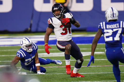 Houston Texans running back David Johnson (31) runs against the Indianapolis Colts in the second half of an NFL football game in Indianapolis, Sunday, Dec. 20, 2020. (AP Photo/AJ Mast)