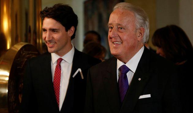 Former Canadian Prime Minister Brian Mulroney (right) and Prime Minister Justin Trudeau at a ceremony in Ottawa, Dec. 6, 2016.