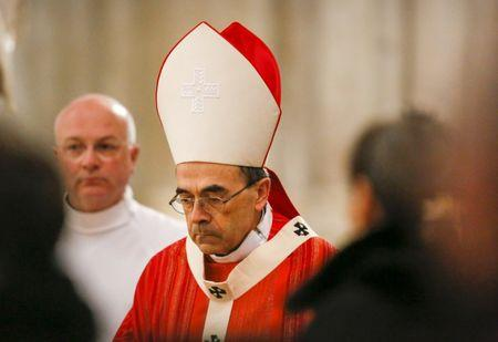 French Archbishop Philippe Barbarin attends a Good Friday mass in Saint-Jean Cathedral in Lyon
