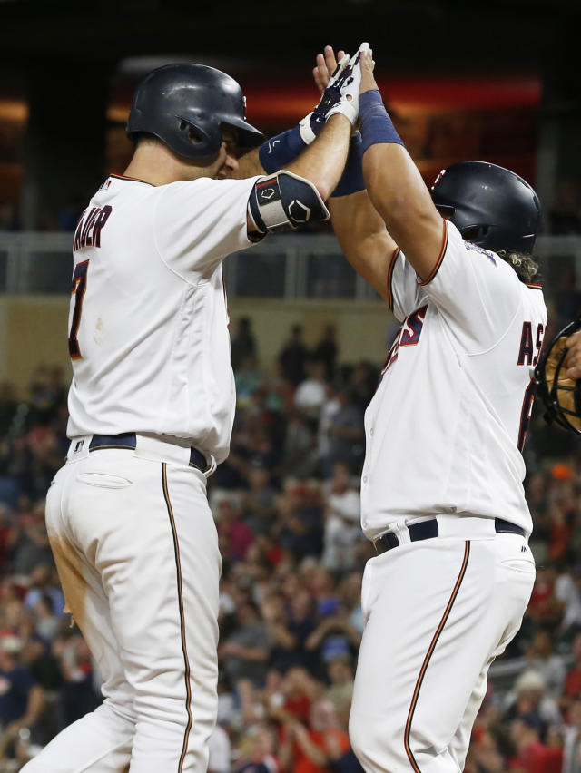 Minnesota Twins' Joe Mauer, left, celebrates his his grand slam off New York Yankees pitcher Tommy Kahnle with Williams Astudillo n the fifth inning of a baseball game Tuesday, Sept. 11, 2018, in Minneapolis. (AP Photo/Jim Mone)