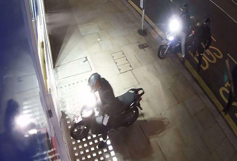 "CCTV video grab issued by the Metropolitan Police of a moped gang during a Kensington High Street ram raid, the gang have been jailed for a string of bold ""professional, planned and organised"" high profile raids across London. (PA)"