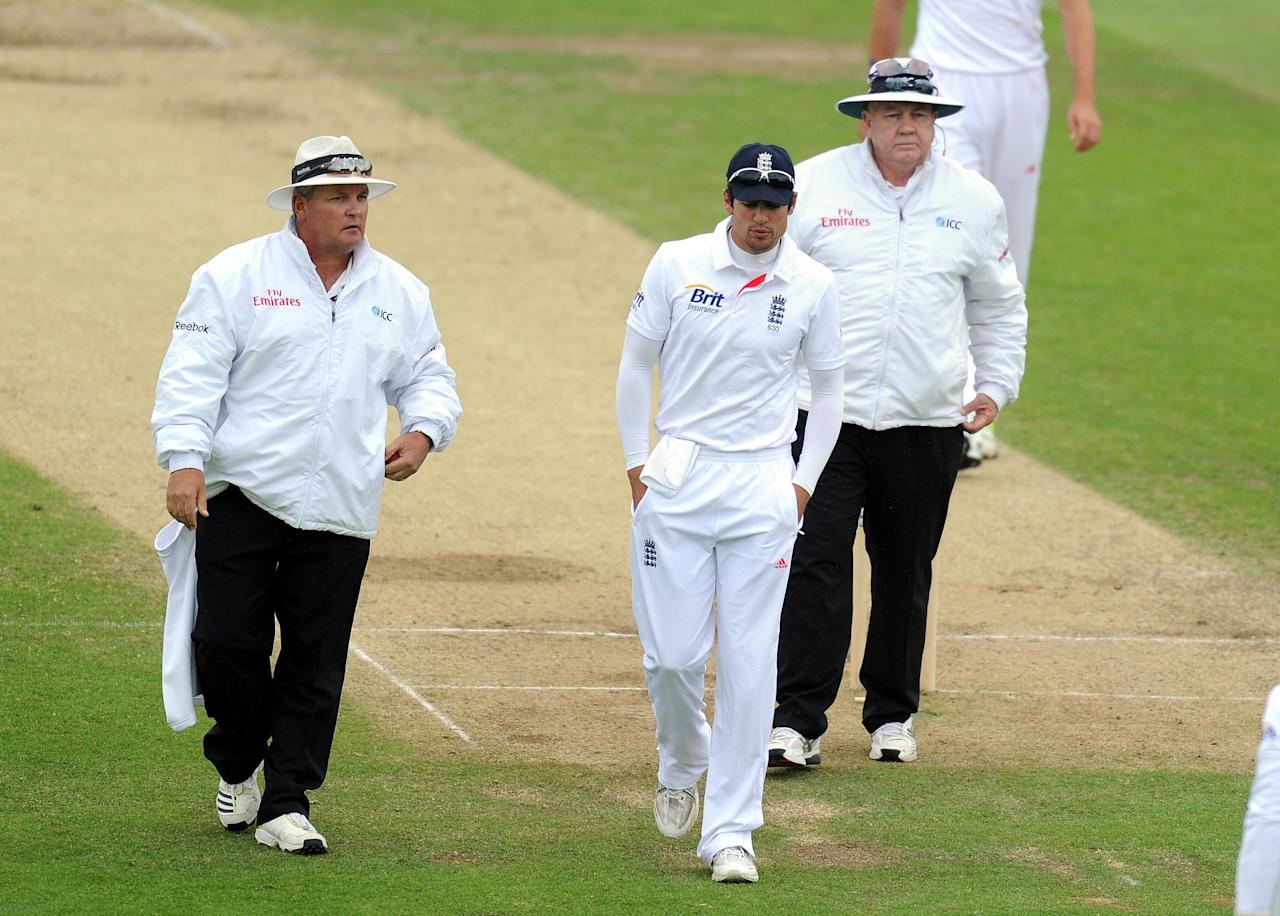 England's captain Alastair Cook walks off after rain stops play during the Second Investec at Headingley, Leeds.