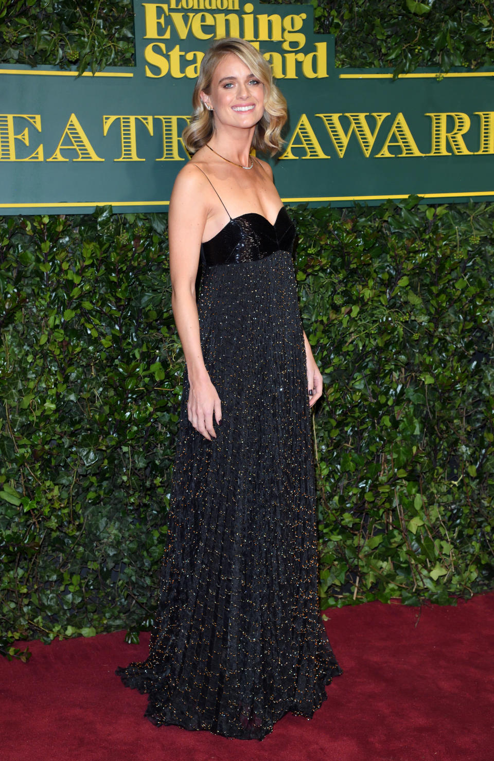 <p>The dancer, actress and ex-girlfriend of Prince Harry dressed in a sparkly black design. <i>[Photo: Getty]</i> </p>