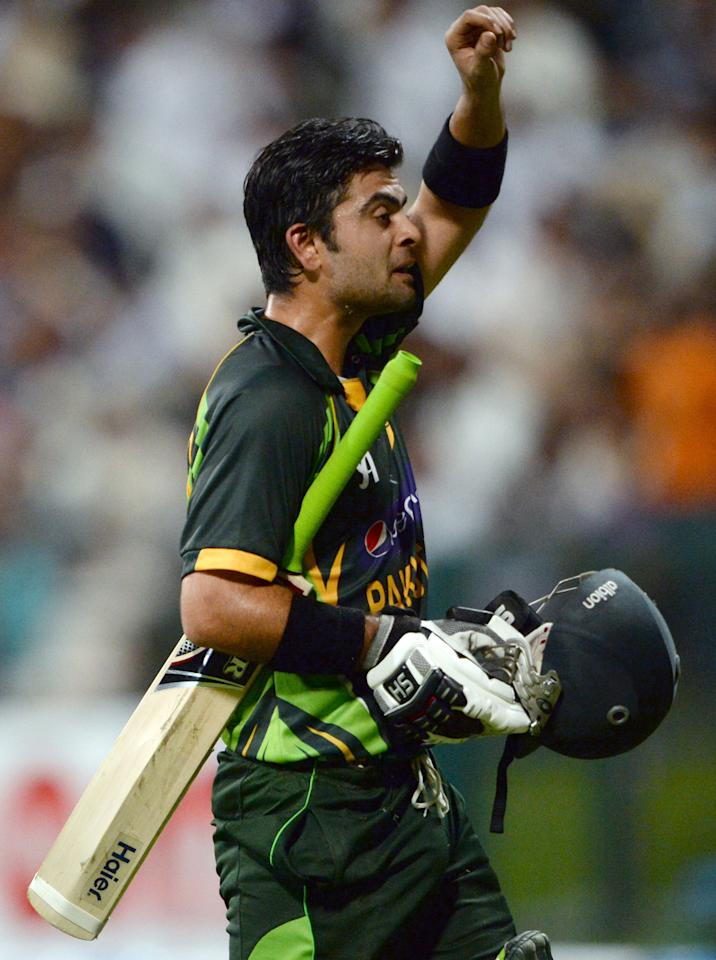 Pakistani batsman Ahmad Sehzad leaves the field after being dismissed during the fourth day-night international in Sheikh Zayed Cricket Stadium in Abu Dhabi on November 8, 2013. Pakistan were chasing a stiff target of 267 in 50 overs. South Africa had made 266-5 in their 50 overs with opener Quinton de Kock hitting 112. South Africa lead the five-match series with 2-1. AFP PHOTO/ Asif HASSAN        (Photo credit should read ASIF HASSAN/AFP/Getty Images)