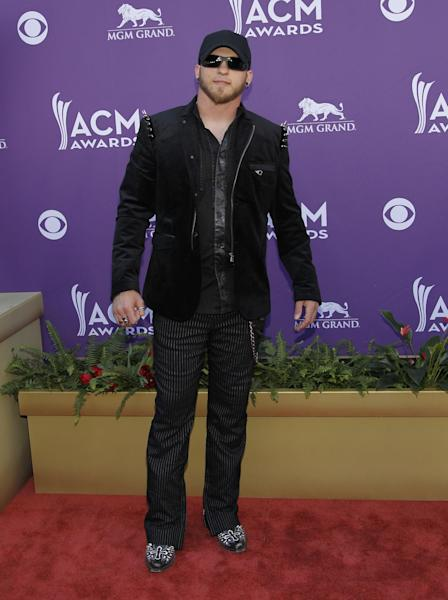 Brantley Gilbert arrives at the 47th Annual Academy of Country Music Awards on Sunday, April 1, 2012 in Las Vegas. (AP Photo/Isaac Brekken)